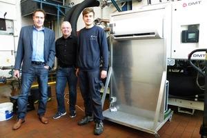 """<div class=""""bildtitel"""">Meinolf Gringel (DMT), Peter Bachmann (BIV) und ein Monteur der Firma Zeller nach erfolgreicher Inbetriebnahme des Propan-Klimageräts</div>"""