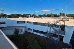 """<div class=""""bildunterschrift_ueberschrift"""">Installation der Versuchsanlage am Kramer-Gebäude</div>"""
